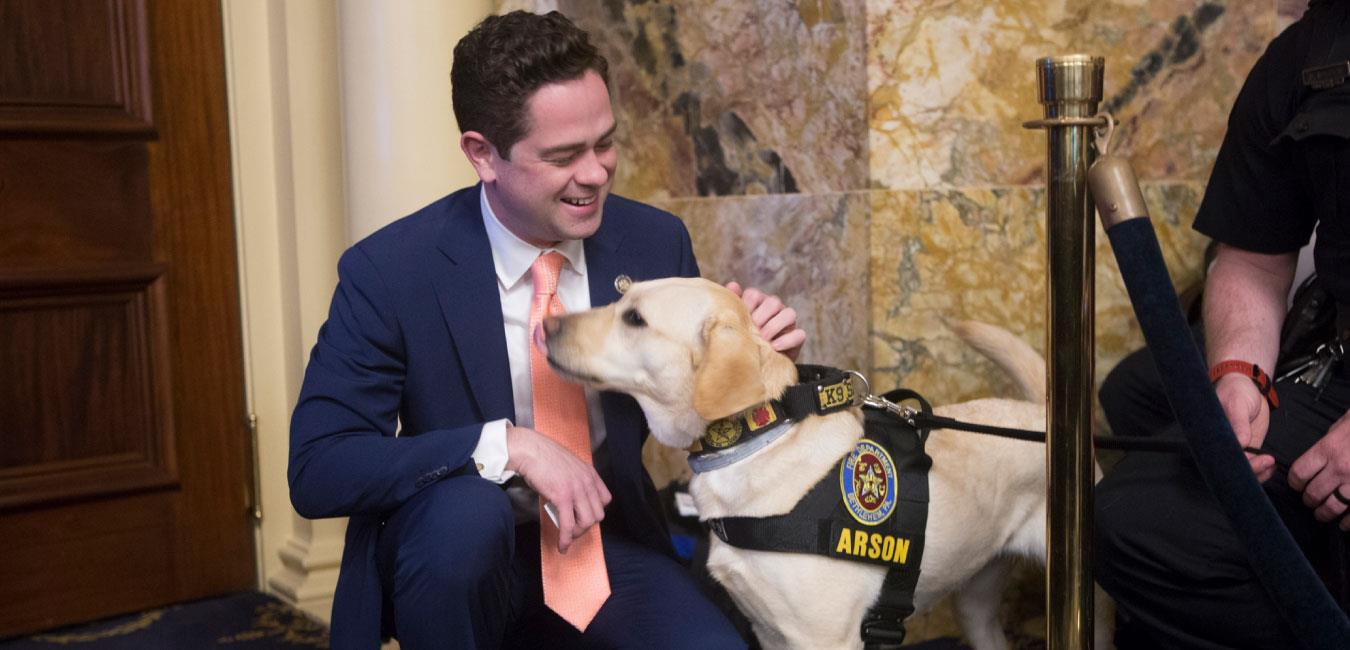 Representative Mullins petting K-9 police dog on House floor