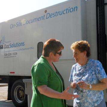 I share a light moment with Alice Souders of Waynesburg during the free document-shredding event that I helped sponsor at the Greene County Fairgrounds.