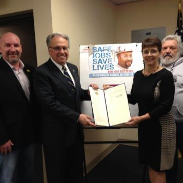 Rep. Eddie Day Pashinski presenting a Workers' Memorial Resolution to member of the Luzerne County Labor Council.