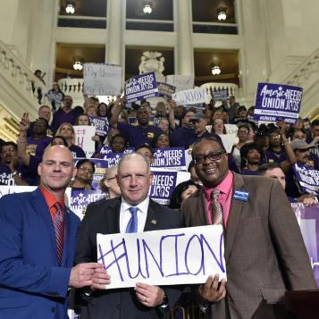 "Reps. Dan Miller and Ed Gainey join advocates and supporters of workers' rights at an SEIU ""Workers Rise-Up Day"" rally."