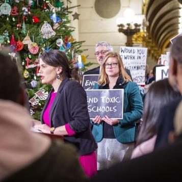 Rep. Leanna Krueger attends a rally calling for emergency school facilities funding and support for the re-drafted Emergency School Repair Funding bill.