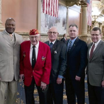Our Photo of the Day takes us to the House Floor as the former Marines serving in the House honor Iwo Jima Veteran Mahlon Fink as part of ceremonies marking the 70th Anniversary of that fateful battle.  From left to right Rep. Jake Wheatley, Mr. Fink, Rep. Harry Readshaw, Rep. Neal Goodman, Rep. Hal English.