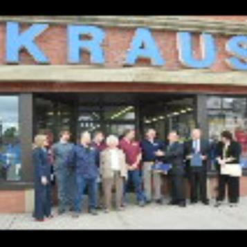 Rep. Harkins presents a citation to the staff of the world-famous Kraus Department Store in Erie, honoring them for 125 years in business.