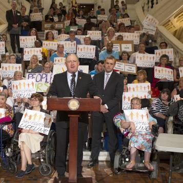 Rep. Dan Miller speaks at a disability funding rally in Harrisburg, calling for cuts to human services be restored.
