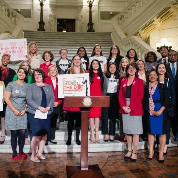 Rep. Elizabeth Fiedler attends a rally to support legislation that would provide free menstrual products in public schools, universities, and public spaces.