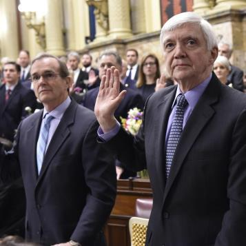 Democratic Leader Frank Dermody, right, and Democratic Whip Mike Hanna are joined by their colleagues taking the oath of office during the swearing-in ceremony, the event officially opening the General Assembly's activities for the 2017-18 legislative session.