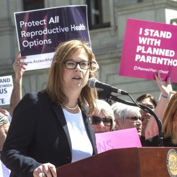 Rep Leanne Krueger-Braneky speaks in support of reproductive rights at a Capitol rally held to stand against anti-choice legislation.