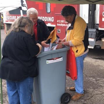 Rep. Dom Costa and others collect paper documents for shredding to prevent identity theft and save the environment.