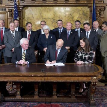 Reps. John Galloway and Marc Gergely join others as Governor Tom Wolf signs a bill providing 44,000 additional people with unemployment insurance and makes cost-saving changes to pay for it.