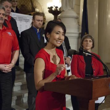 Rep. Patty Kim calls for an increase in the minimum wage at a rally at the State Capitol with a coalition of labor, religious, community, women's and worker's groups.