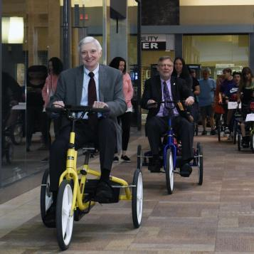 Democratic Leader Frank Dermody lead an adaptive bike parade for children with disabilities at Pittsburgh Mills mall.