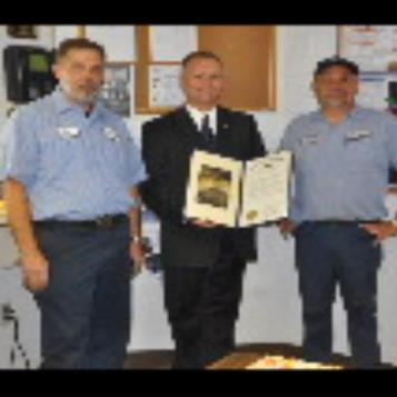 Rep. Harkins presents a citation to Tim Rockwell and Clyde Hagan, who both recently reached 1 million safe miles as drivers for Con-Way Freight.