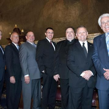 Rep. Harkins welcomes Fr. Jerry Priscaro,Priest at St. Ann's, St. Casimir's & Holy Family Roman Catholic Churches, Erie, Pennsylvania Area. Joining them are, from l-r, Speaker of the House Sam Smith, and the Erie area Reps., Curt Sonney, Greg Lucas, Ryan Bizzarro and Flo Fabrizio
