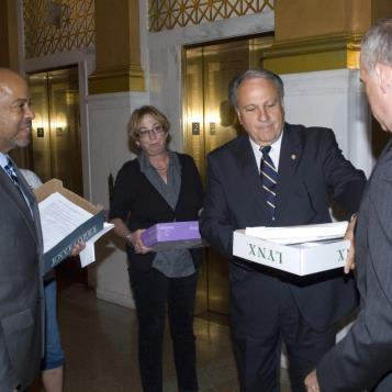 Rep. Pashinski delivers 15,000 statements and petitions to state Education Secretary Ron Tomalis outside the Governor's Reception Room to request restoration of public school funding in the state budget. Since Gov. Corbett took office he has slashed Pre-K to 12 classroom funding by nearly $1 billion and Accountability Block Grants for early education have been cut by 60 percent from $250 million to $100 million. The burden of paying for schools has fallen on the backs of property taxpayers, schools have cut academic and nonacademic programs and 14,000 jobs have been eliminated. From left are Rep. James Roebuck, D-Phila., Democratic chairman of the House Education Committee, Pashinski and Tomalis.