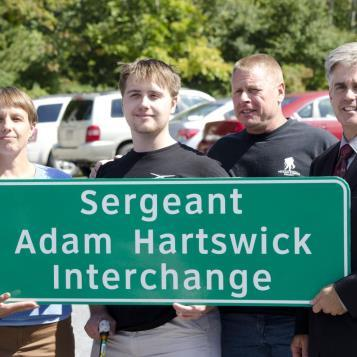 At a dedication ceremony held in Pine Grove Mills on Sept. 18, 2014, state Rep. Scott Conklin renamed a portion of state Route 45 in Centre County as the Sgt. Adam Hartswick Interchange. Conklin was joined at the dedication by Sgt. Hartswick and members of his family- various local, state and federal officials- and members of local veterans' organizations.