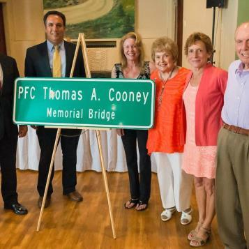 Senator John Wozniak joins Rep. Frank Burns and members of PFC Thomas A. Cooney family in a bridge naming ceremony.  The bridge over Route 22 will be named the Cooney Road bridge as an honor to PFC Cooney, a Silver Star recipient who was killed in action during World War II.