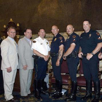 The state House of Representatives unanimously adopted a resolution introduced by Rep. Harkins, commemorating the Erie Police Department Motorcycle Unit on its 100th anniversary and for its dedicated service to the citizens of the City of Erie. Pictured left to right: Rep. Harkins; House Speaker Keith R. McCall; Lt. Pat Durkin; Sgt. Aaron Wassell; patrolman Gary Taccome; patrolman Robert Wierbinski; patrolman Thomas Dunmyer, Jr.; and Rep. Flo Fabrizio.