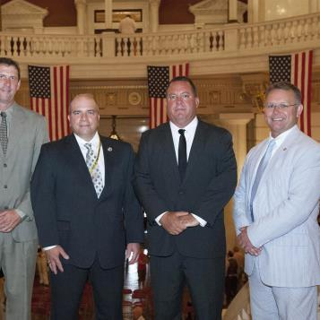 Rep. Harkins, along with Rep. Fabrizio, welcomes firefighters from Erie to the state Capitol.